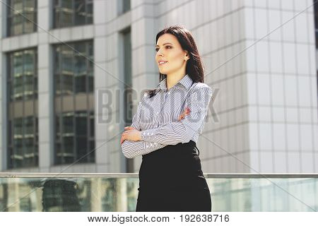 Confident Beauty. Portrait Of Attractive And Cheerful Business Lady In Smart Casual Wear Keeping Arm