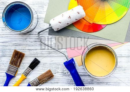 Set of tools for painting on grey wooden table background top view.