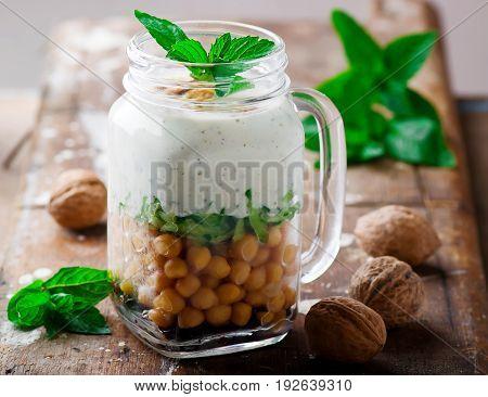 minty yogurt parfaits in the jar.style rustic.selective focus