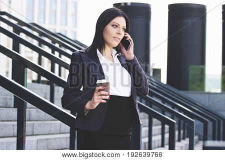 Always In Touch. Portrait Of Confident Attractive Business Woman In Smart Casual Wear Talking The Ph