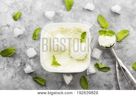 Mint Ice Cream In Bowl And Spoon For Ice Cream On A Gray Background. Top View. Food Background