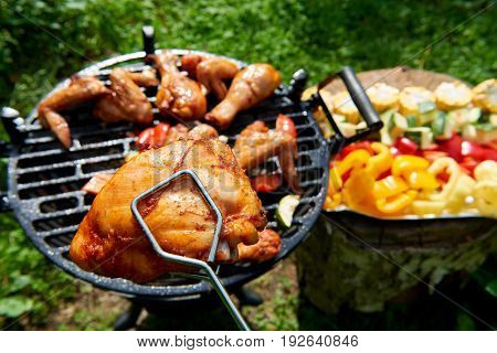 Meat and vegetables during grilling. Assorted types of chicken