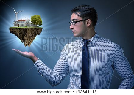 Businessman holding flying island in eco concept
