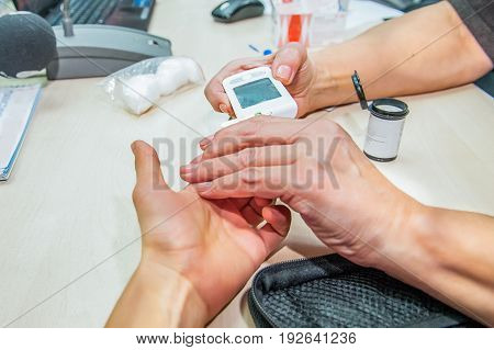 Close Up Process Of Mobile Diabetes Testing For Sugar Level. Normal Blood Sugar Level. Doctor Takes