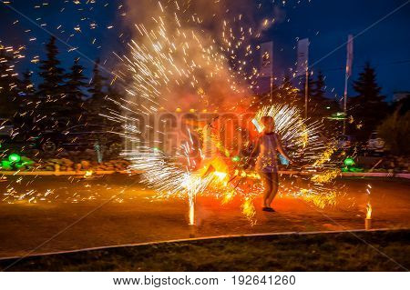 Bright Night Fire Show. Artists Make Performance On The Streets Of The City. Public Entertainment Co