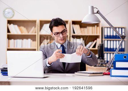 Businessman receiving letter envelope in office