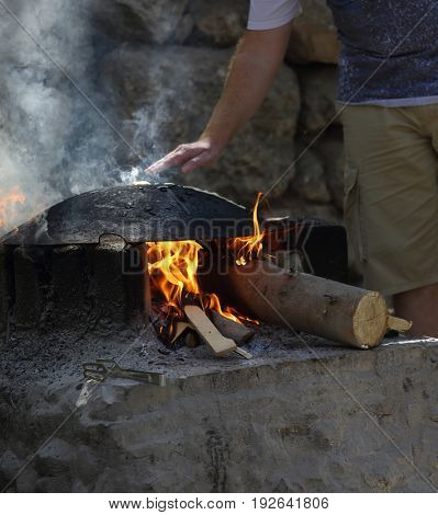 At the festival, people bake flat cakes in the Druze oven