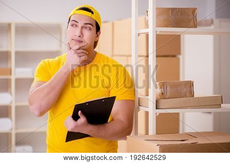 Man working in postal parcel delivery service office