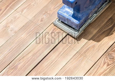 Photo of wooden floor and blue grinder