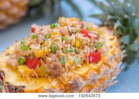 Thai pineapple stuffed with fried rice, chicken and vegetables