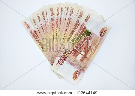 a lot of 5000 banknotes of Bank of Russia on white background Russian rubles spine 100 banknotes of five thousand rubles