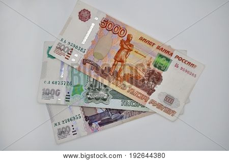 three banknotes 5000 1000 500 five-thousandth banknotes of Bank of Russia on white background Russian rubles