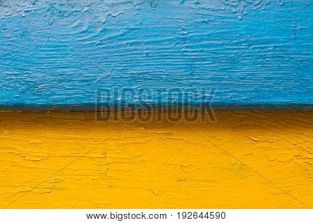 Old retro bench in the street. The combination of colors is similar to the flag of the state of Ukraine. Color image blue yellow. Horizontal frame