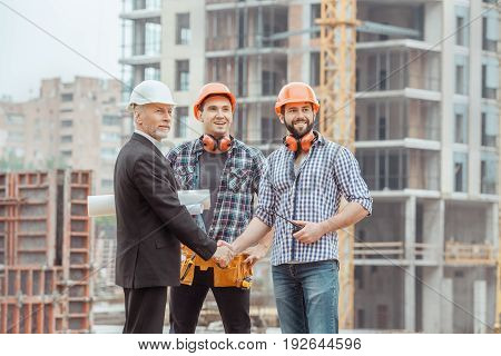 Male work building construction engineering occupation shaking hands
