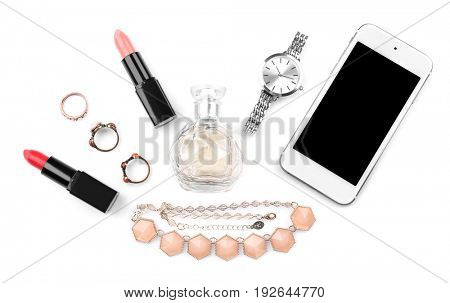 Perfume, accessories, cosmetics and phone on white background