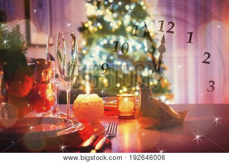 Countdown to holiday celebration. Double exposure of clock and Christmas table setting