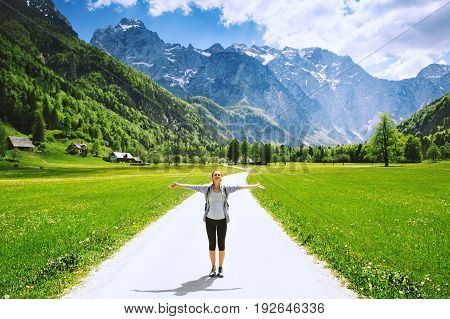 Logar valley or Logarska dolina Slovenia Europe. Hiking woman on nature background with Alps and mountain valley. Hiker girl in mountains. Photo of travel inspiration freedom healthy lifestyles