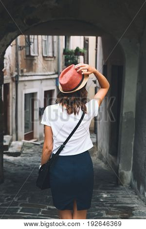 Woman Walks On The Historical European Streets Of Old Town.