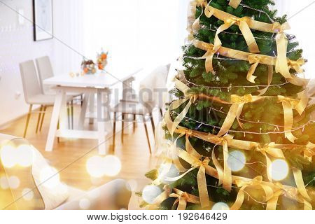 Beautiful decorated Christmas tree in living room, closeup. Festive and blurred lights design. Celebration of new year 2018