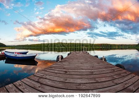 Beautiful summer sunset in the lake or river. the evening sun illuminates the clouds with warm light