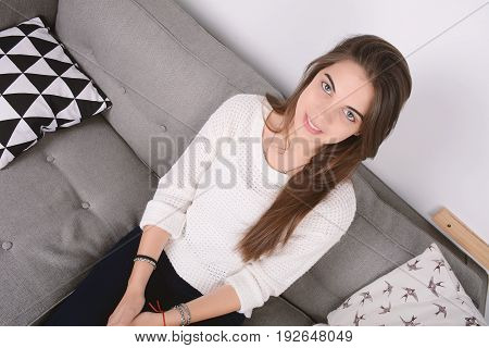 Woman Relaxed On Couch.