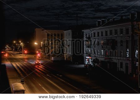 Night City Life: Car On The Road And Street Lamps