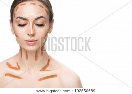 Attractive woman has different concealers on neck and face. She closing her eyes. Portrait. Isolated and copy space