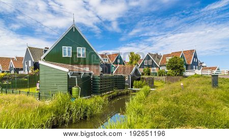 Traditional Dutch Village Scene With Wooden Houses And Canal