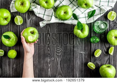 ripe green apples on dark wooden table background top view space for text
