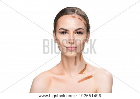 See difference. Assured young lady is looking at camera with light smile and half of her face is ready made with foundation. Portrait. Isolated