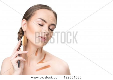 Relaxed pretty lady is holding cosmetic tassel and going to use it on her face. Portrait. Isolated and copy space