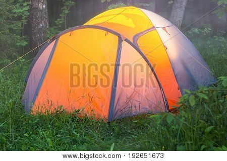 The Light Burns In A Tent, An Early Foggy Summer Morning