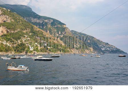 Boats moored at the Amalfi coast near Positano Campania Italy