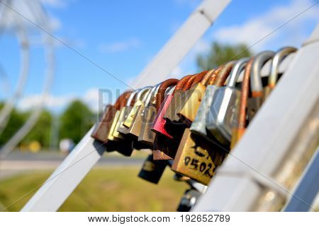 Padlocks in love on the bridge on a sunny summer afternoon Wilanow Warsaw