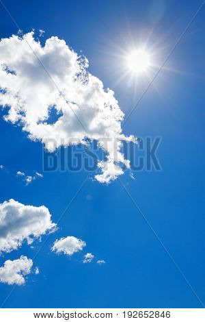 background from blue sky with white clouds and sun. summer landscape.
