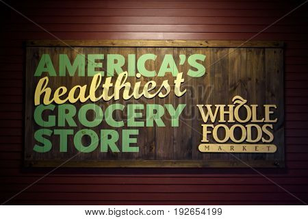 Wooden Whole Foods Market sign with slogan