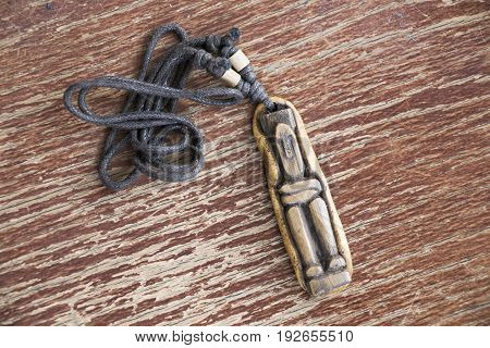 Wooden figure necklace talisman from southeast asia.
