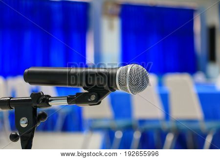 microphone wireless on a stand in meeting room seminar empty conference background: Select focus with shallow depth of field.