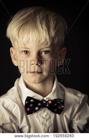 Handsome Little Blond Boy In A Stylish Bow Tie
