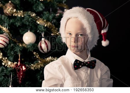 Little Boy In A Bow Tie Celebrating Christmas