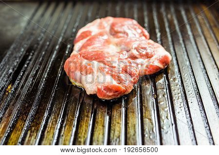 closeup of a steak on grill. Grilled meat.
