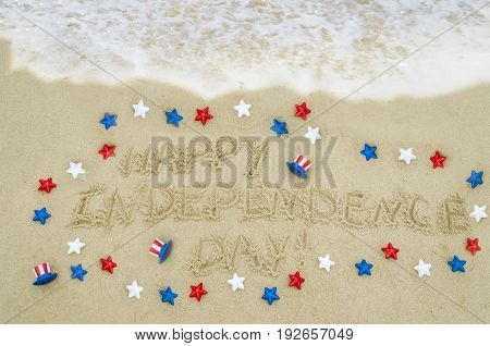 Independence USA background with red blue and white stars on the sandy beach near ocean