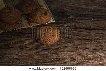Coffee cookie and copy space on wooden background.