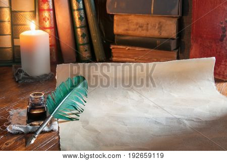 Quill pen old papers and books by candle light