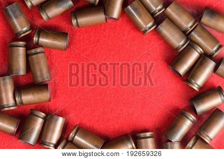 The Metal Frame Of The Empty Cartridge Cases From Under Small-caliber Pistols On A Red Background