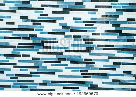 closeup of white brick wall with blue paint stains