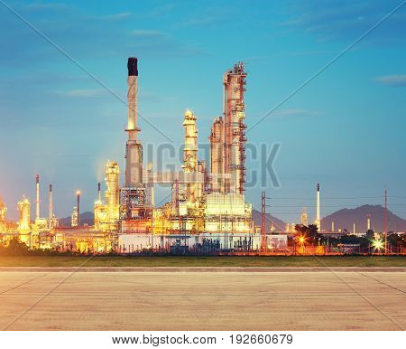 Oil refinery factory and concrete pavement at twilight with sky background.