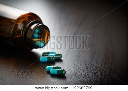 Pill Bottle Spilling Pills Packaging Of Tablets And Pills On The Table