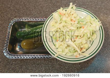 Cole slaw and pickles appetizer served in New York Deli