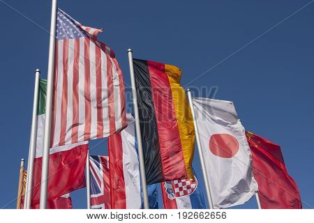 International flags waving on a sunny day